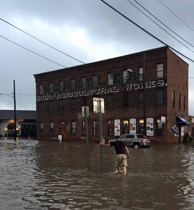 Rains continue to pound saturated ground, flash flooding occurring, and bridge collapses in Newark Valley