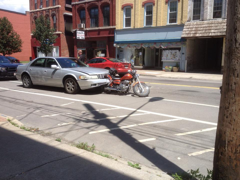 Vehicle and motorcycle crash sends two to hospital in Owego