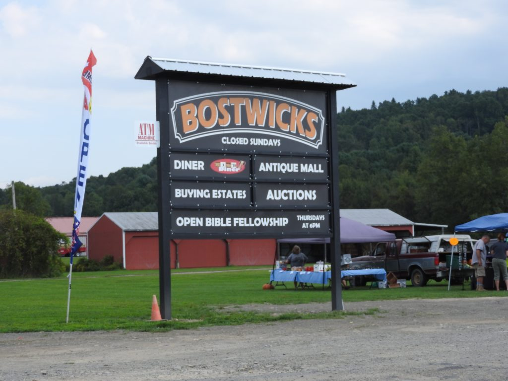 Bostwick celebrates the opening of the Auction Mall