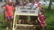 S-VE students and the Lions Club plant in the Community Garden