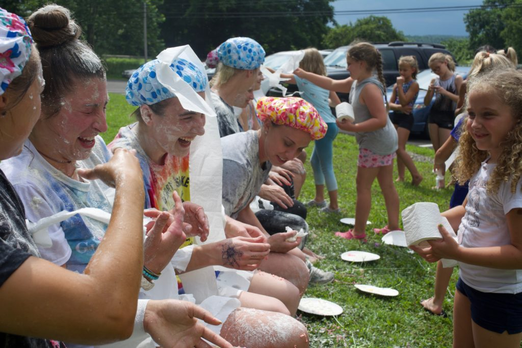 Day campers collect food for Rural Ministries