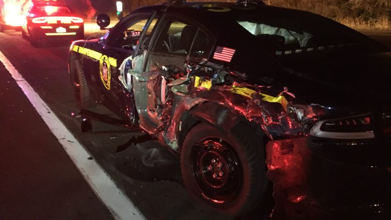 Truck driver strikes state police vehicle, arrested for DWI