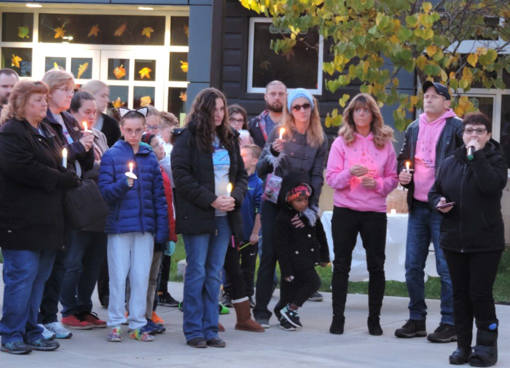 Community mourns Allen siblings at vigil