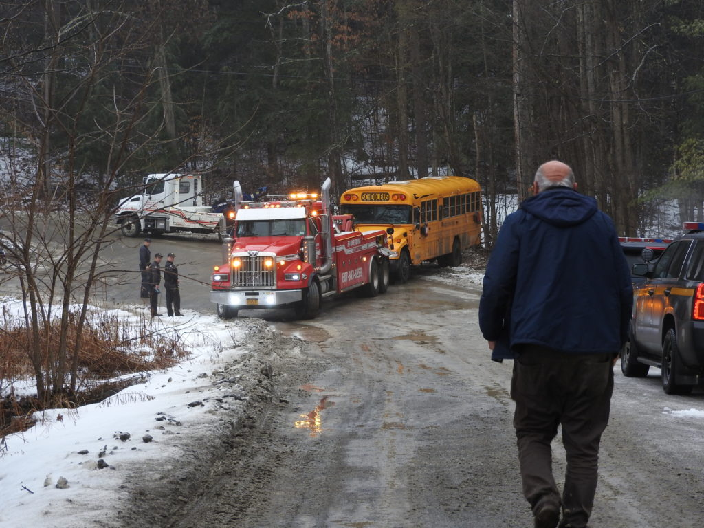 Bus rolls over on icy road in Candor; two students on bus