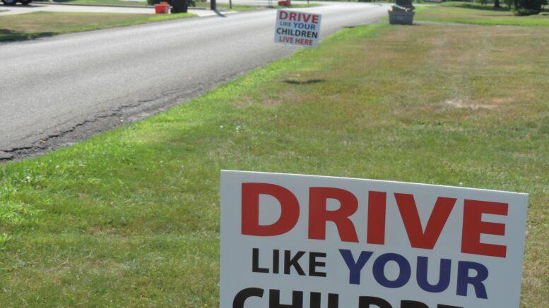 Neighborhood signs staged to alert motorists