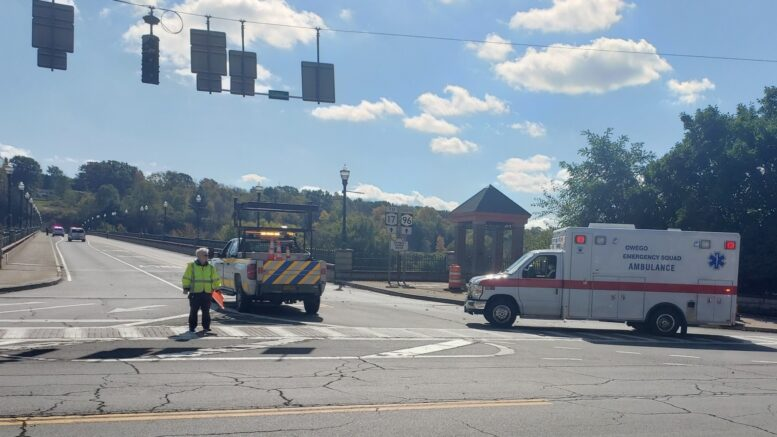 Police respond to emergency calls at the Court Street Bridge